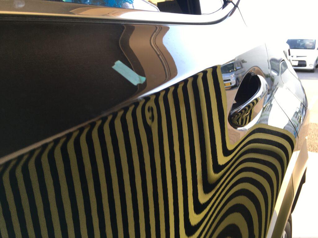 レクサスNX200tリアドアに出来たヘコミをデントリペアで直します。